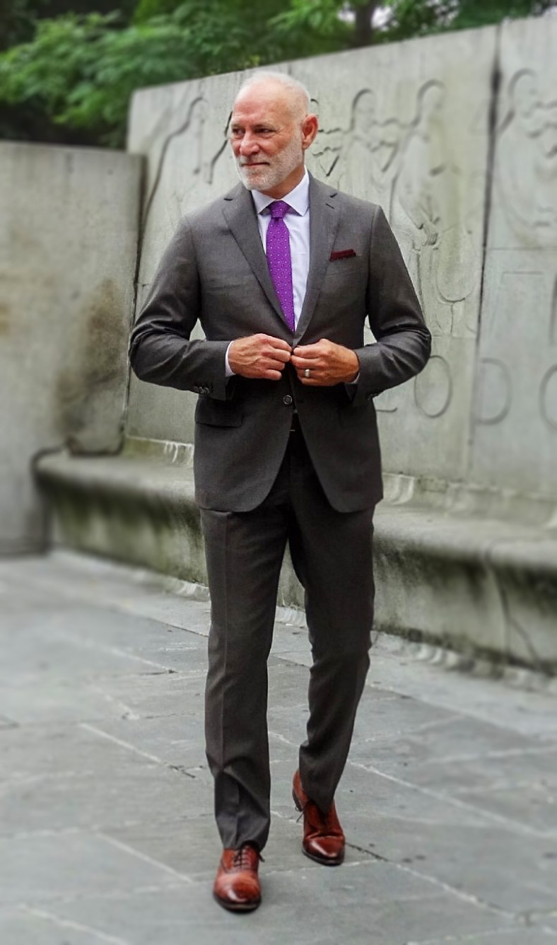 Randy-brown-suit-purple-tie